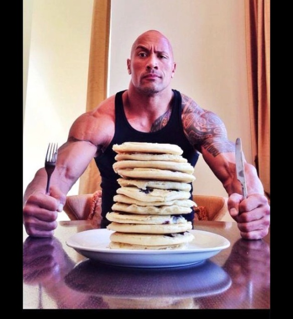 The Rock... who consumes mountains of food on his cheat days.